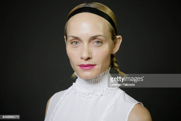 Model Amber Valletta is seen backstage before the HM Studio show as part of the Paris Fashion Week on March 1 2017 in Paris France