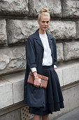 Model Ameline Valade wears a Jill Sander coat Hermes bag and skirt and Dior ring on day 7 of Paris Collections Women on March 09 2015 in Paris France