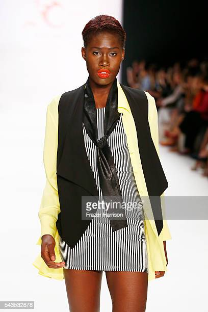 Model Aminata Sanogo walks the runway at the Anja Gockel show during the MercedesBenz Fashion Week Berlin Spring/Summer 2017 at Erika Hess Eisstadion...