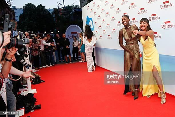 Model Aminata Sanogo wearing a dress designed by Marcel von Berlin and moderator Alexandra Maurer wearing a dress designed by Marcel von Berlin...