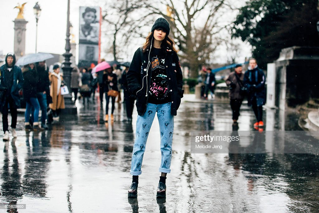 Model Ana Cristina wears customized vintage Bowsdontcry from Noir Kennedy sequin sweater and jeans with illustrations after the Leonard Paris show at...