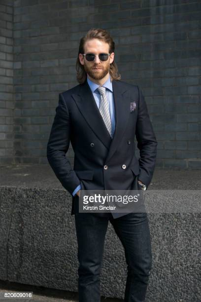 Model and Actor Craig McGinlay wears Massimo Dutti jeans Chester Barrie Blazer shirt tie and pocket square Finlay and Co sunglasses on day 3 of...