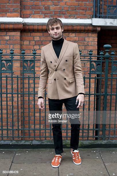 Model and actor Douglas Booth wears all Topman and Adidas trainers on day 1 of London Collections Men on Januay 8 2016 in London England Douglas Booth