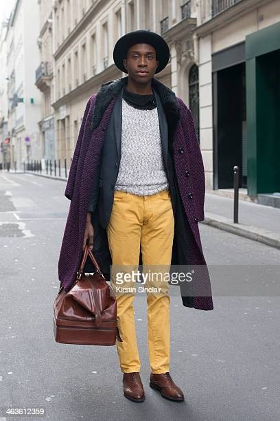 Model and Actor Zion Ama Dio wears Zara Jacket trousers and shoes Givenchy coat Berlutti bag H and M socks and vintage jumper and hat day 4 of Paris...
