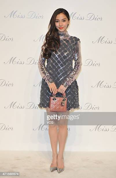 Model and actress Angelababy attends the Miss Dior exhibition opening at Ullens Center for Contemporary Art on April 29 2015 in Beijing China