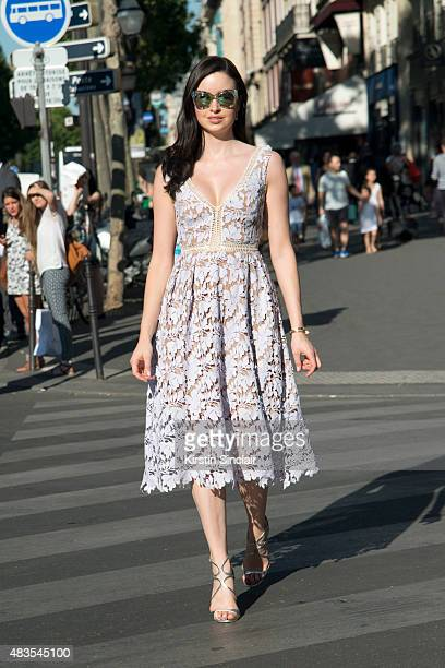 Model and actress Emma Miller wears a Self Portrait dress Jimmy Choo shoes Cartier bracelet Gucci sunglasses and Elisa Lee earnings on day 2 of Paris...