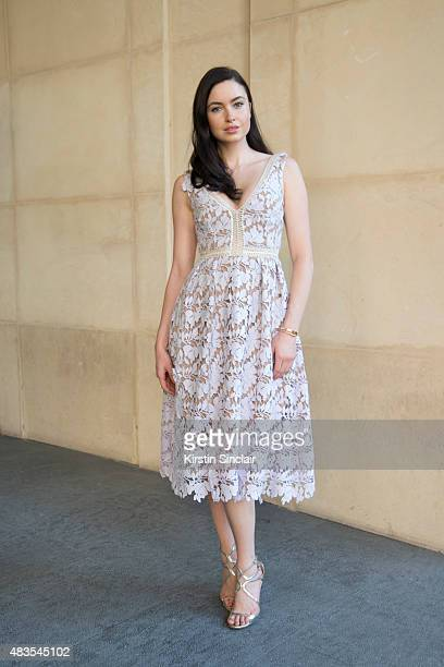 Model and actress Emma Miller wears a Self Portrait dress Jimmy Choo shoes Cartier bracelet and Elisa Lee earnings on day 2 of Paris Fashion Week...