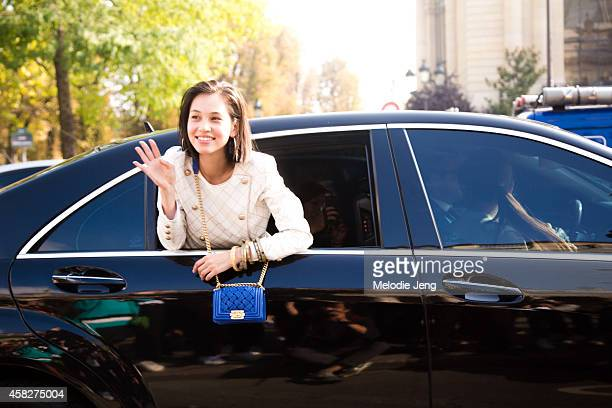 Model and actress Kiko Mizuhara exits the Chanel show by car in a Chanel outfit at Grand Palais on Day 8 of Paris Fashion Week Spring/Summer 2015 on...