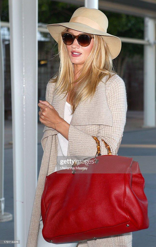 Model and actress Rosie HuntingtonWhiteley arrives in Australia for a Hayman Island photo shoot as new ambassador for Australian beauty brand ModelCo...