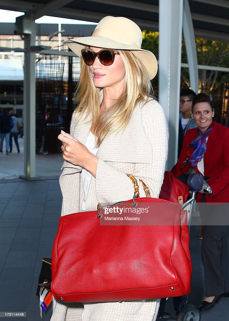 Model and actress, Rosie Huntington-Whiteley arrives in Australia for a Hayman Island photo shoot as new ambassador for Australian beauty brand, ModelCo at Sydney International Airport on July 8, 2013 in Sydney, Australia.