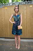 Model and actress Suki Waterhouse wears Burberry dress and bag Stella McCartney shoes and Rolex watch on day 4 of London Collections Men on June 15...
