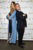 Model and designer Behati Prinsloo poses with DuJour's Jason Binn as he hosts the launch of Behati X Juicy Couture at PHD at Dream Downtown on March...