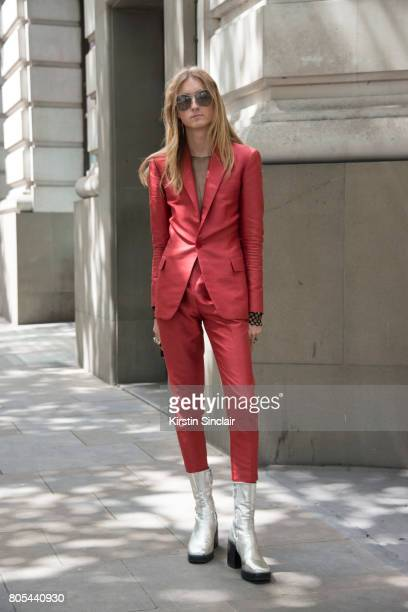 Model and designer Harris Reed wears Balenciaga boots Valentino suit Gucci sunglasses and his own design top on day 1 of London Collections Men on...
