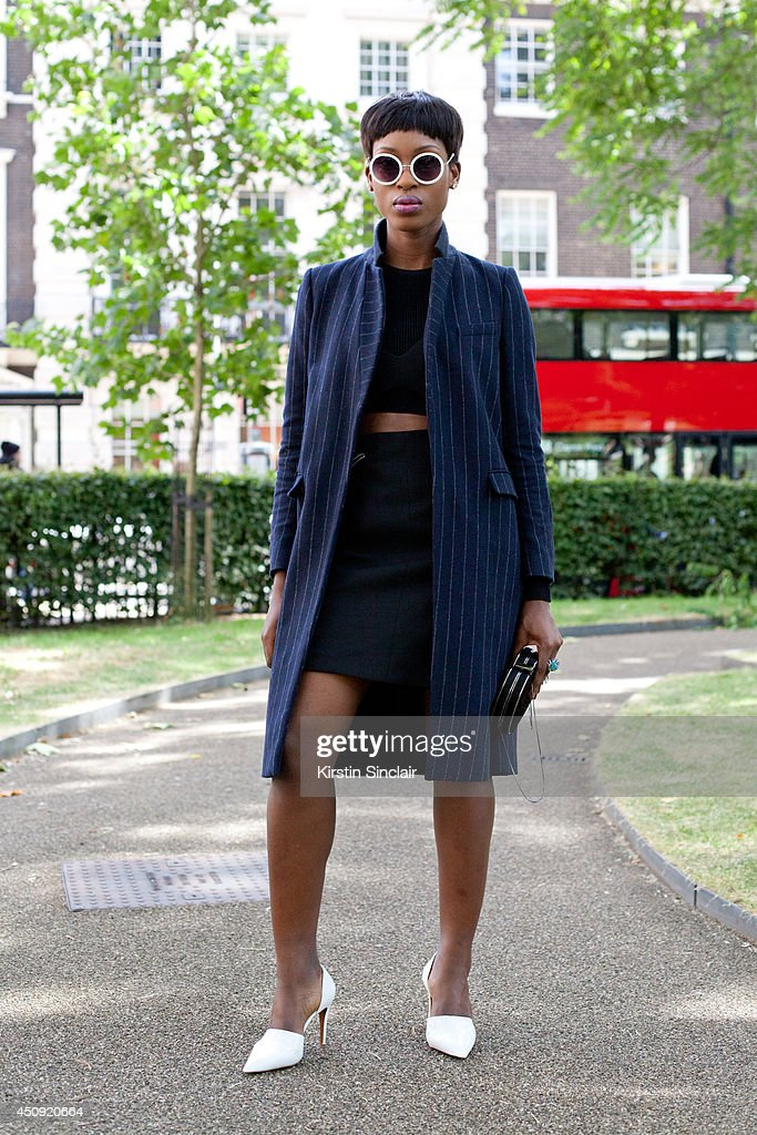 Model and Designer Jacqui Akrofi wears Topshop sunglasses, Zara crop top, skirt, bag and shoes on day 3 of London Collections: Men on June 17, 2014 in London, England.