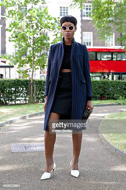 Model and Designer Jacqui Akrofi wears Topshop sunglasses Zara crop top skirt bag and shoes on day 3 of London Collections Men on June 17 2014 in...