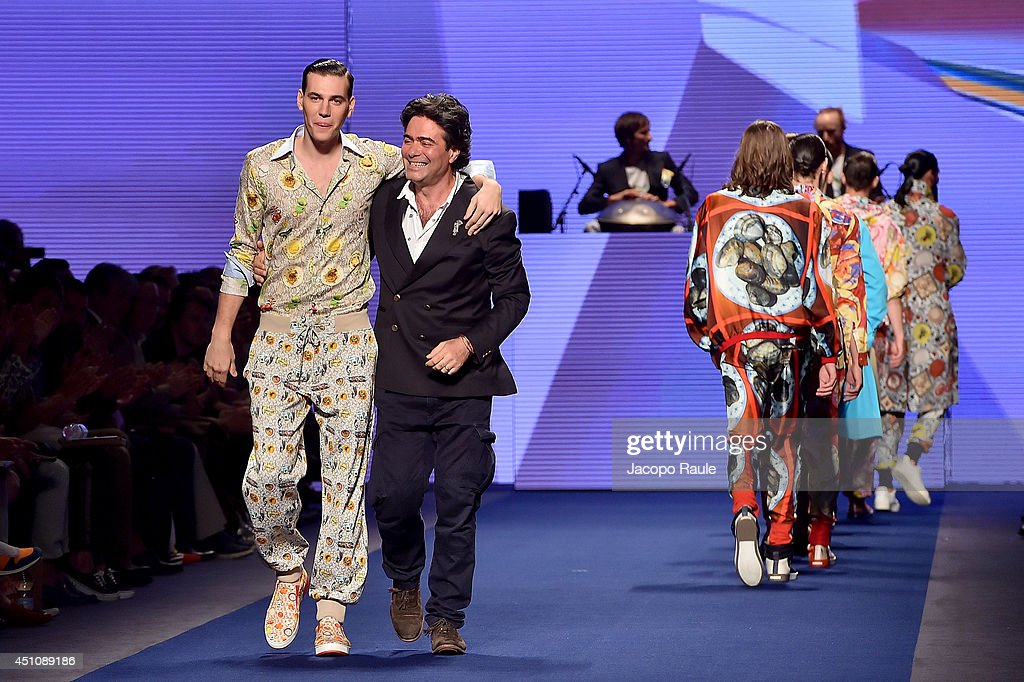 A model and designer <a gi-track='captionPersonalityLinkClicked' href=/galleries/search?phrase=Kean+Etro&family=editorial&specificpeople=2967727 ng-click='$event.stopPropagation()'>Kean Etro</a> (R) walk the runway after the Etro show as part of Milan Fashion Week Menswear Spring/Summer 2015 on June 23, 2014 in Milan, Italy.