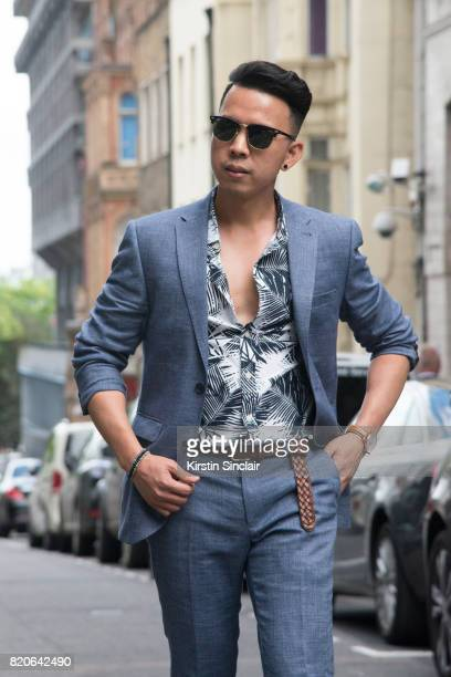 Model and Digital influencer Erwin Mateo wears a Next suit Primark Polo shirt Brathwait watch and Ray ban sunglasses on day 1 of London Collections...
