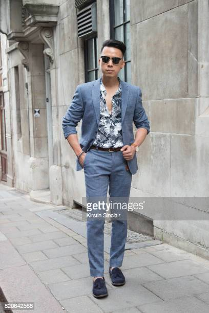 Model and Digital influencer Erwin Mateo wears a Next suit Primark Polo shirt Brathwait watch Zara shoes and Ray ban sunglasses on day 1 of London...