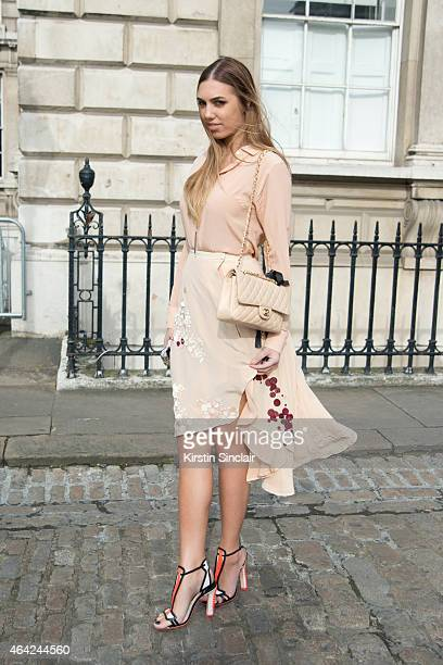 Model and DJ Amber Le Bon wears Palma Harding top and dress Sophia Webster shoes and a Chanel handbag on day 3 of London Collections Women on...