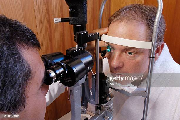 Model And Doctor Ophthalmology Exam To Measure The Ocular Tension Glaucoma Screening