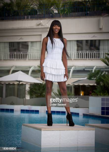 Model and executive producer Naomi Campbell poses during a photocall for the 'The Face' at Hotel Majestic on October 8 2013 in Cannes France