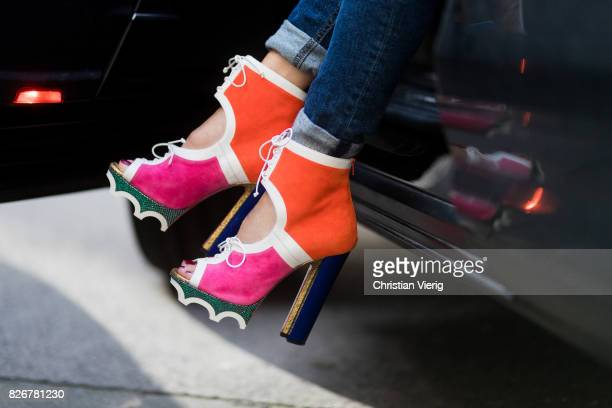 Model and fashion blogger Alexandra Lapp getting out of a car wearing color blocking heels from Christian Louboutin and Gucci sunglasses on August 5...