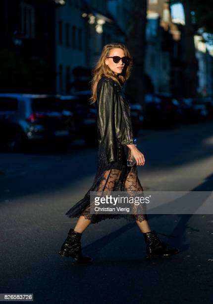 Model and fashion blogger Alexandra Lapp wearing a SelfPortrait lace dress in black Perfecto leather biker Jacket from Schott NYC studded punk...