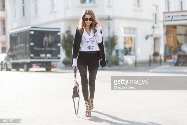 Model and fashion blogger Alexandra Lapp wearing Karl Lagerfeld a black leather leggings in biker style from Karl by Karl Lagerfeld Karl Lagerfeld's...