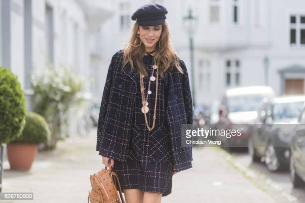Model and fashion blogger Alexandra Lapp wearing tweed dress and coat from Steffen Schraut Balmain x HM sandals Strak backpack by MCM Chanel tweed...