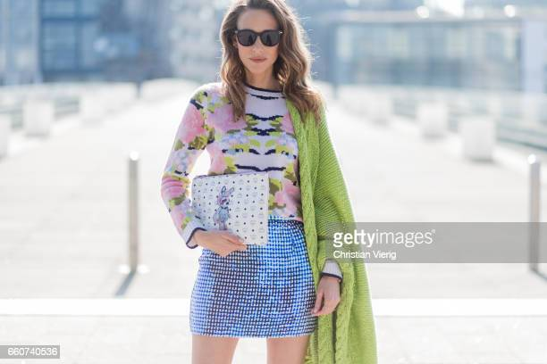Model and fashion blogger Alexandra Lapp wearing wearing a sequin skirt by Ashish stole / shawl and pullover made of cashmere from Heartbreaker black...