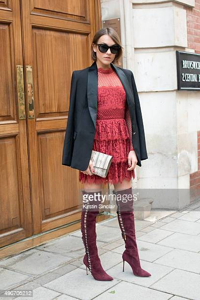 Model and Fashion Blogger Ella Catliff wears a Temperley jacket and dress Hugo Boss bag Dsquared sunglasses and Gianvito Rossi boots on day 3 during...
