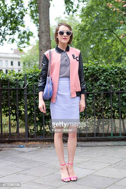Model and fashion blogger Ella Catliff wears a Whistles jacket Rebecca Minkoff bag Carven shirt Holly Cullen skirt and Kurt Geiger shoes on day 2 of...