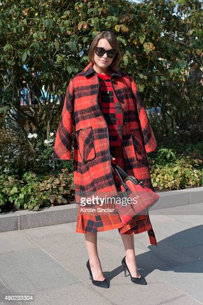 Model and Fashion Blogger Ella Catliff wears all Kate Spade Maje shoes and Dsquared sunglasses on day 3 during London Fashion Week Spring/Summer...