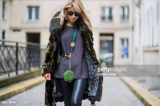 Model and fashion blogger Gitta Banko wearing a darktaupe knitted cashmere sweater by Bruno Manetti fake fur camouflageoptic coat Irina by AirField...