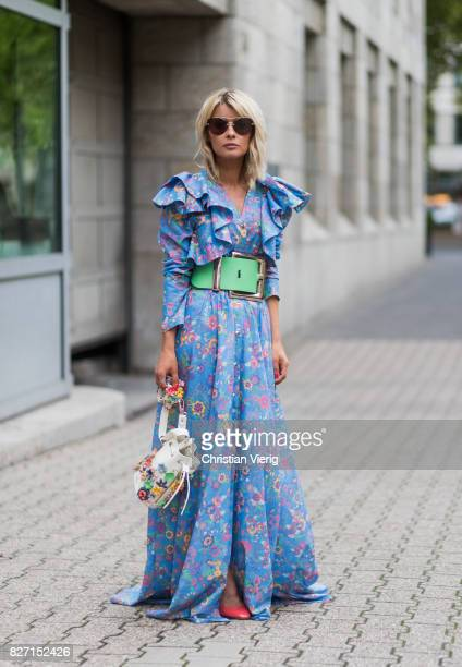 Model and fashion blogger Gitta Banko wearing a floralpatterned dress and a pastelgreen oversize waist belt by Marina Hoermanseder a Kasper Flowers...