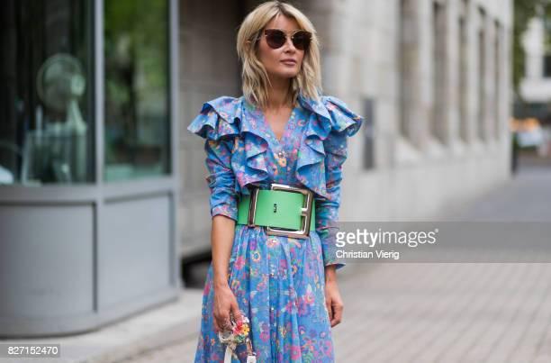 Model and fashion blogger Gitta Banko wearing a floralpatterned dress and a pastelgreen oversize waist belt by Marina Hoermanseder a Kasper Flowers...