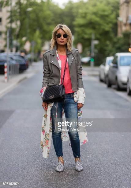 Model and fashion blogger Gitta Banko wearing a light grey biker leather jacket by Iro a pink top by Marina Hoermanseder floralpatterned silk dress...