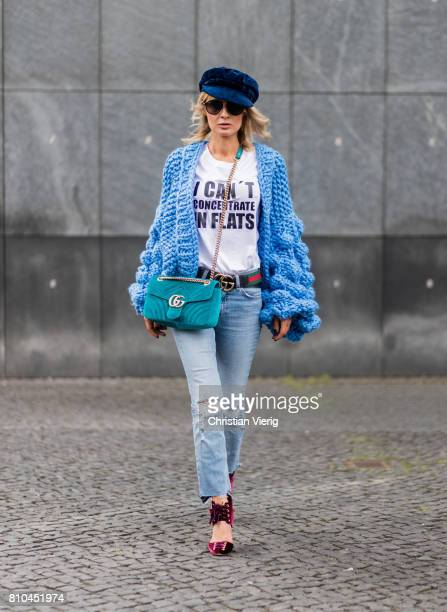 Model and fashion blogger Gitta Banko wearing a lightblue handknitted cardigan by Mums Handmade straightleg jeans with destroyed details by Rag Bone...