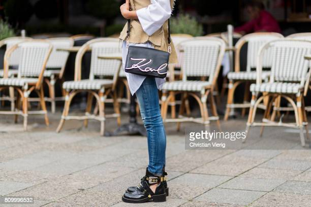 Model and fashion blogger Gitta Banko wearing a white oversize shirt from Mango corsage in destroyed look by Dawid Tomaszewski tight Dsquared 2 jeans...