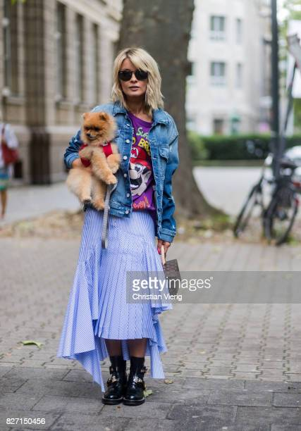 Model and fashion blogger Gitta Banko with a Pomeranian boo dog wearing a stripped pleatedskirt with a cut by Main Label purple handpainted tshirt...
