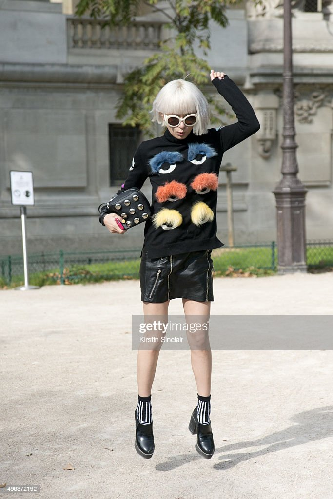 Model and Fashion Blogger Yuri Nakagawa wears Prada sunglasses Fendi top Monki shoes Sly bag and a Little Lilly skirt on day 5 during Paris Fashion...