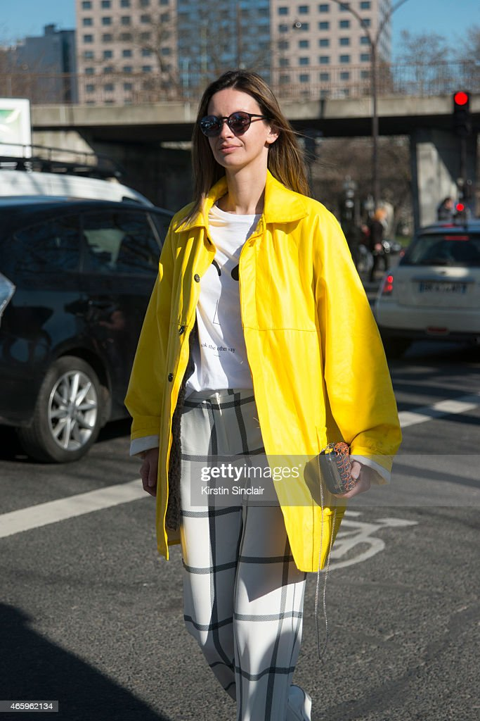 Model and fashion stylist Clara Racz wears a vintage jacket, Mango trousers, Zara t-shirt and bag, and Moscot sunglasses on day 6 of Paris Collections: Women on March 08, 2015 in Paris, France.