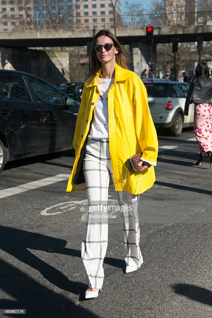 Model and fashion stylist Clara Racz wears a vintage jacket Mango trousers Zara tshirt and bag and Moscot sunglasses on day 6 of Paris Collections...