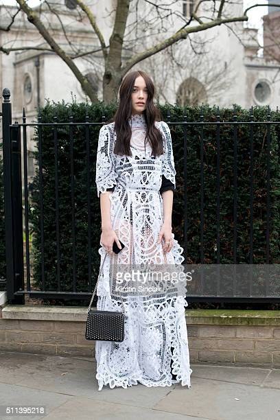 Model and Instagram sensation Elizabeth Jane Bishop wears a Bora Aksu dress Louis Vuitton bag and Christian Louboutin shoes on day 1 during London...