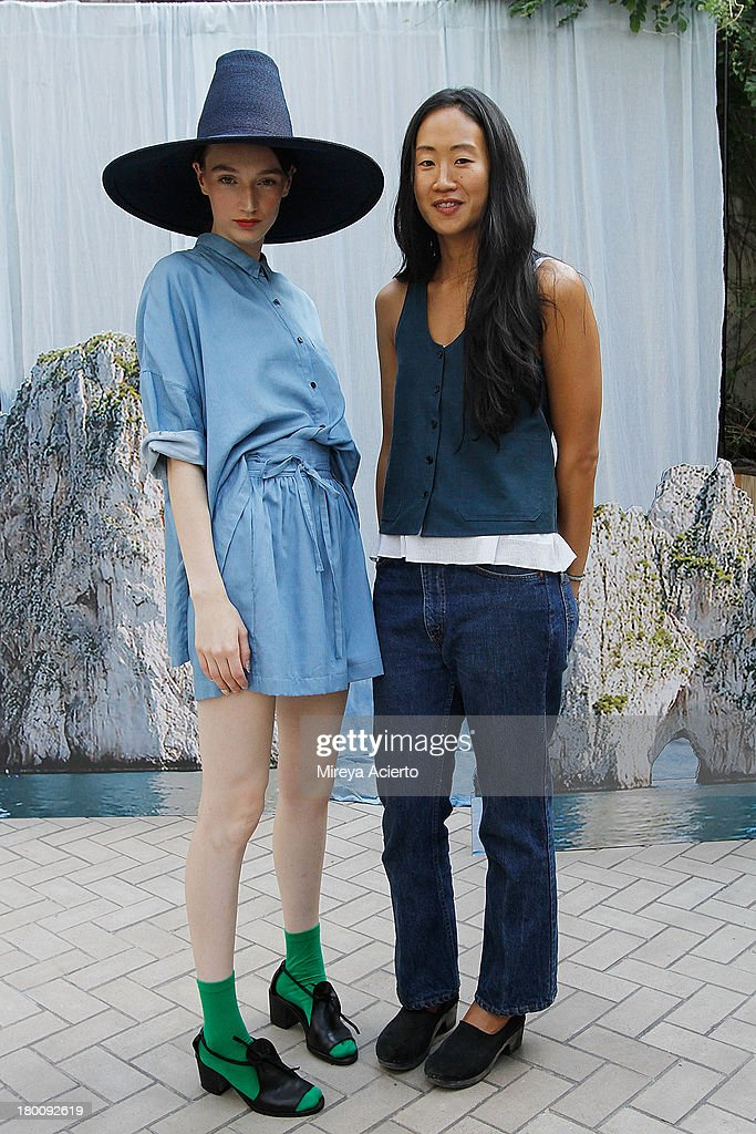 A model and Jade Lai pose backstage at Creatures of Comfort Presentation at Maritime Hotel on September 8 2013 in New York City
