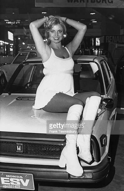Model and later actress Dinah May poses on the bonnet of a Honda saloon car UK 14th October 1975