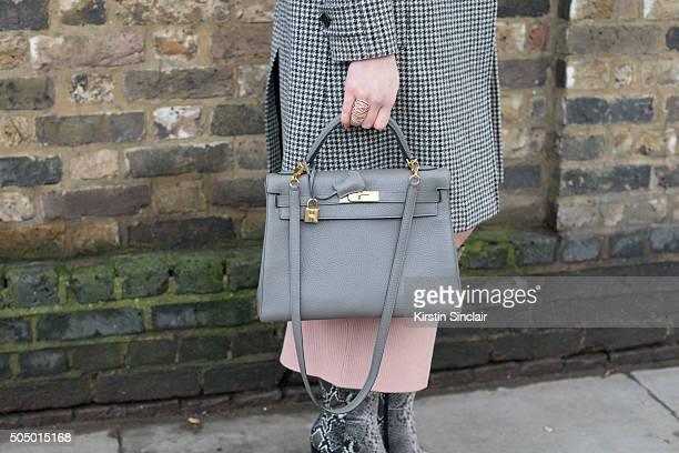 Model and Made in Chelsea star Emma Miller wears a Saint Laurent coat SelfPortrait dress Hermes bag and ASOS boots on day 4 of London Collections Men...
