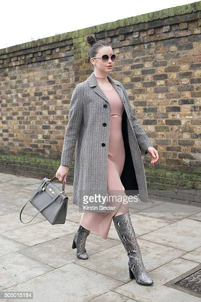 Model and Made in Chelsea star Emma Miller wears a Saint Laurent coat SelfPortrait dress Hermes bag ASOS boots and Chanel sunglasses on day 4 of...