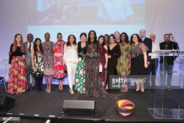 Model and Malaika founder Noella Coursaris Musunka and volunteers at Malaika appear onstage as Malaika hosts Malaika10 honoring Barry Segal Tina...