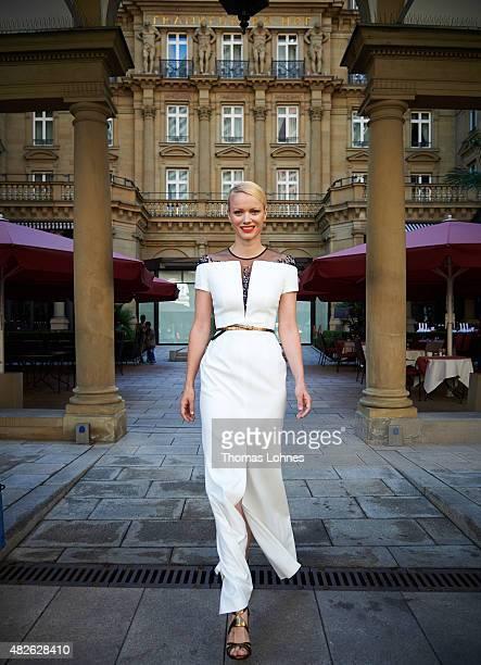 Model and moderator Franziska Knuppe wears 'Escada' evening dress at the hotel 'Frankfurter Hof' on July 31 2015 in Frankfurt am Main Germany...